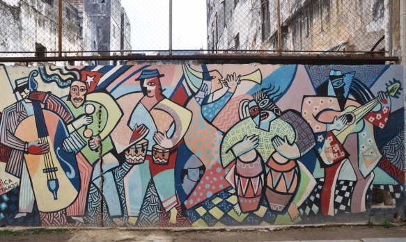 mural on a wall of a group of people, stylized slightly, obviously cuban