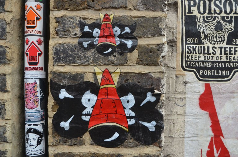 street art, red bombs with black skull and crossbones wings,