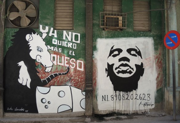 two street art pieces, one is a large rat with a piece of cheese and the words No quiero mas el queso. On the right is a black and white image of a man's head with a number below him. N I 8908202623.