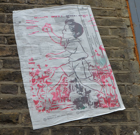 graffiti and street art on fashion street in shoreditch east london, paper paste up of a drawing