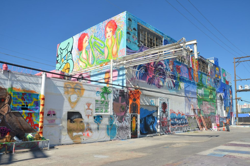 exterior wall of a two storey building that has been covered with street art by a number of different artists