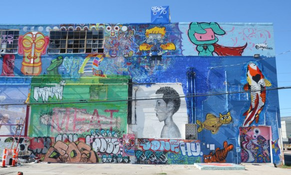 murals and street art on the side of a building, the old Mission Linen building in Las Vegas.
