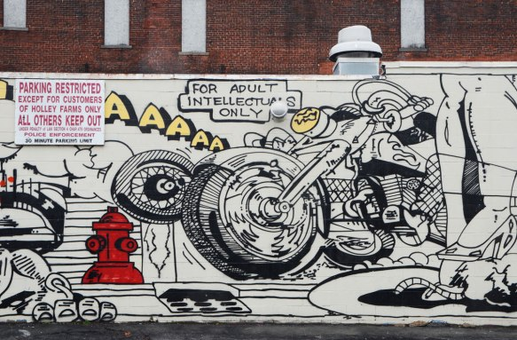 a motorcycle, part of a larger mural