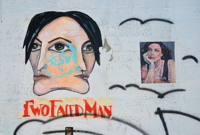 graffiti street art on a white wall -
