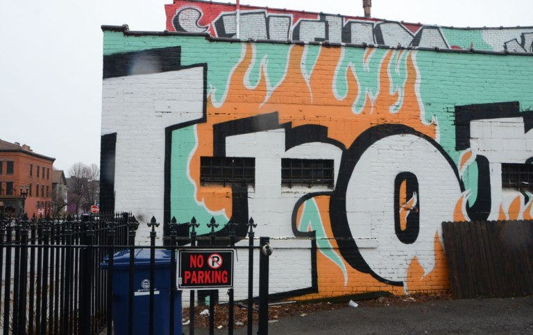 word Iron written in large letters, part of a mural