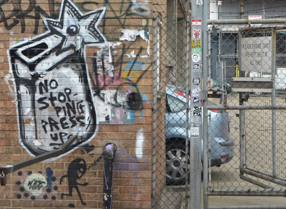 graffiti on a brick wall including a little stick figure man with a large head by n'ice pops, and the words no stopping