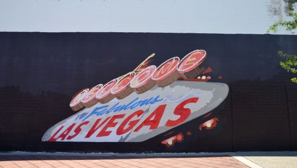 mural of the famous Welcome to fabulous Las Vegas sign painted on the side of a building