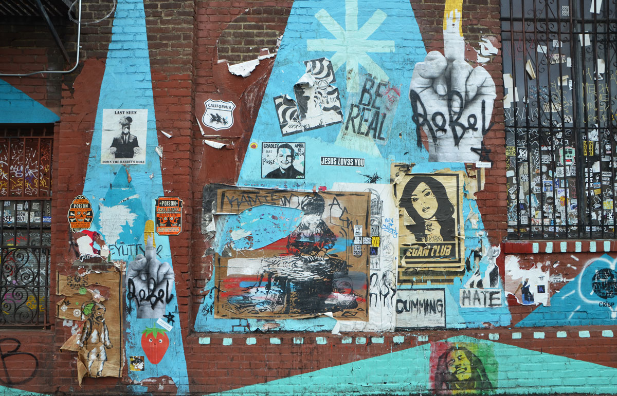 paste up graffiti on the wall of the Angel City Brewery