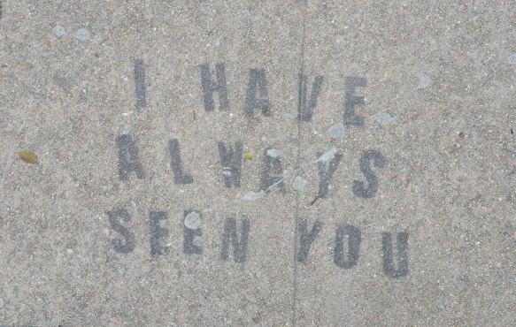 black stencil on grey concrete sidewalk, words I have always seen you