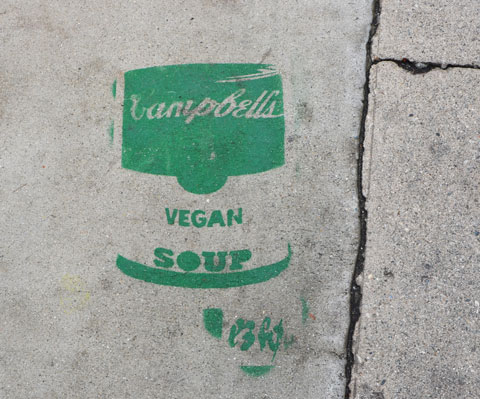 green stencil on grey concrete sidewalk, campbell soup can, vegan soup