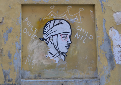 a paste up of a person's head wrapped in an old fashioned bandage that ties under the chin