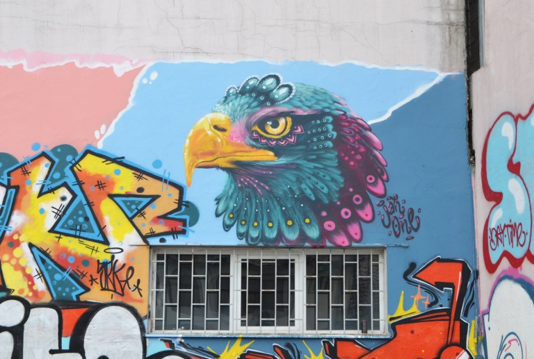 street art mural including an eagle head