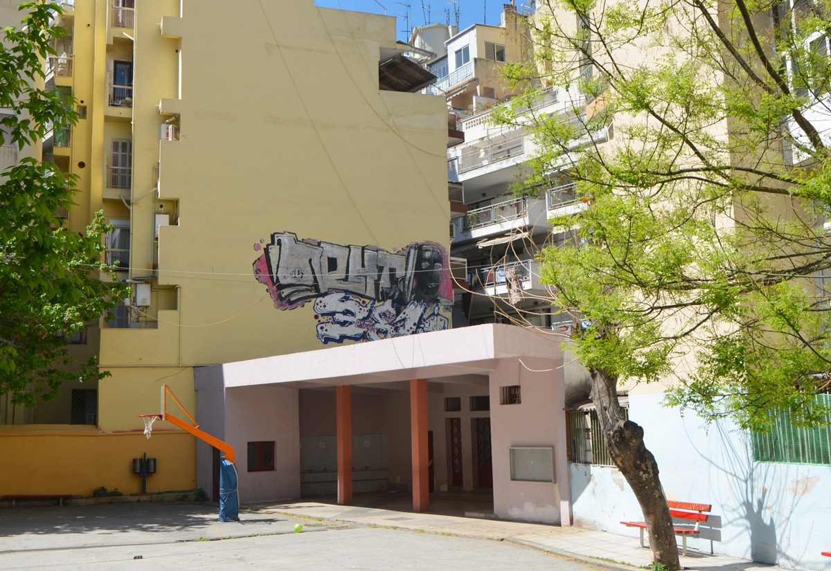 street art in Thessaloniki Greece - a throw up tag above the entrance to a school