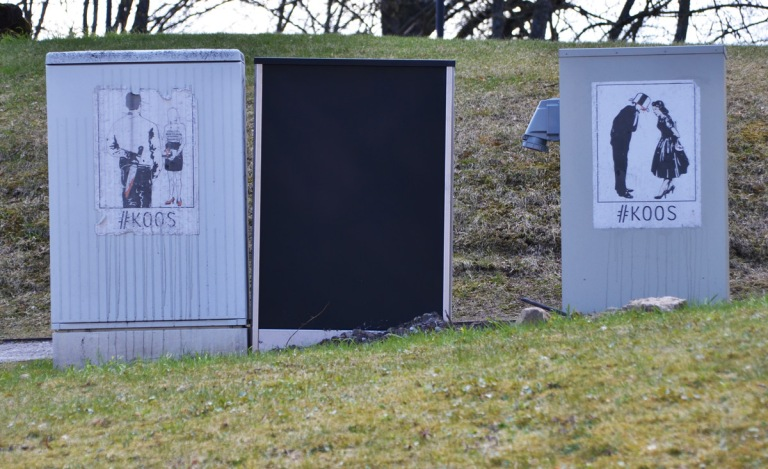 two poster pasteups by #koos Both are of a couple, in one they are kissing