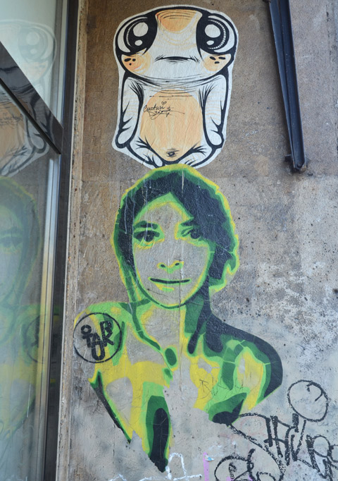 two pasteups, a woman in green and yellow and a creature by creaturi dragute