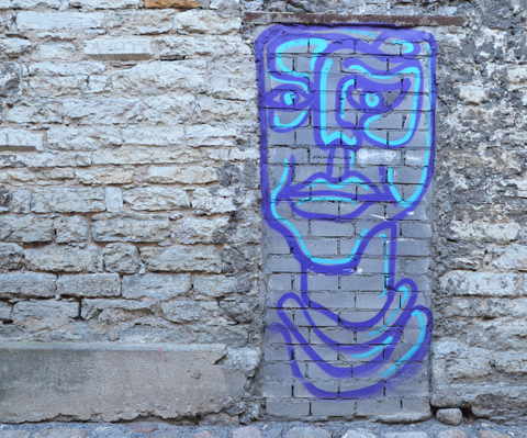 doorway shaped and sized line drawing graffiti in purple with turquoise highlights, a man's head and neck