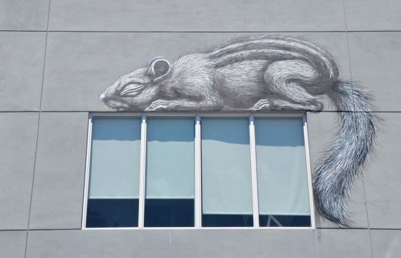 small rodent sleeping on top of a window, black and white mural by ROA