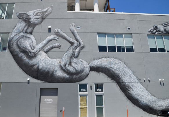 father adult rodent in mural by roa
