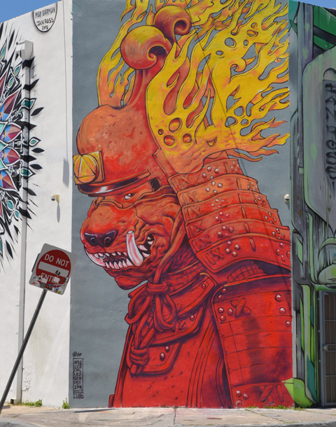 a mural by a squid called sebastien, flaming helmet on his head, dog like face, red robes