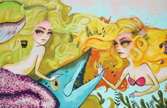 two mermaids with yellow hair in a mural by tati in downtown hollywood florida, tatunga, mermaids are with a large blue fish