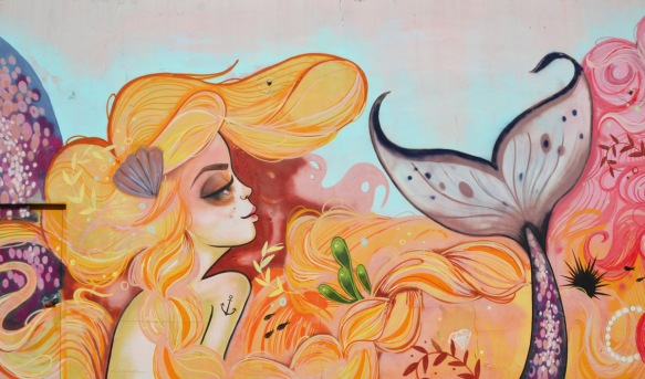 light orange coloured hair on a mermaid with purple tail