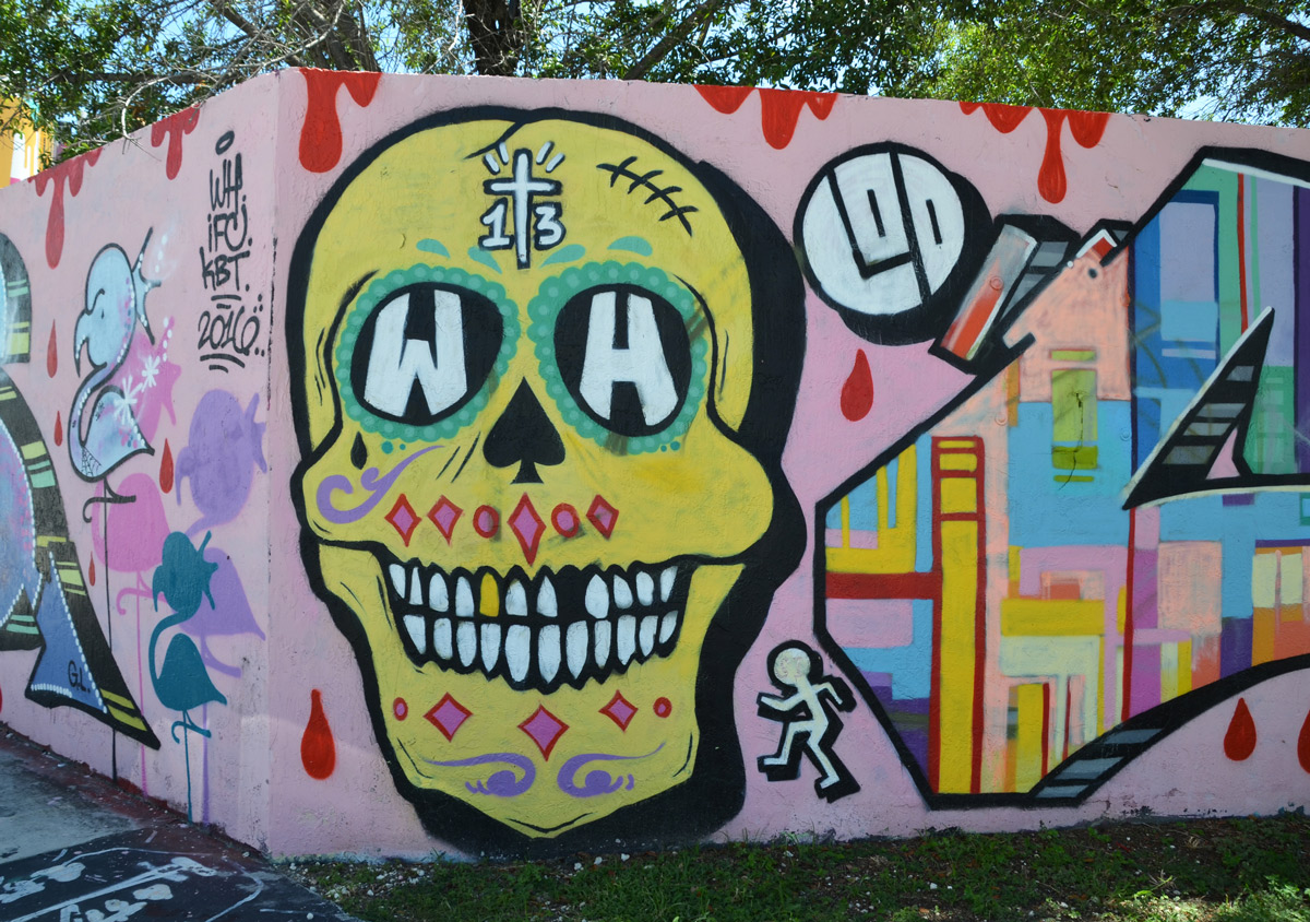 yellow decorated skull on pink horadings.