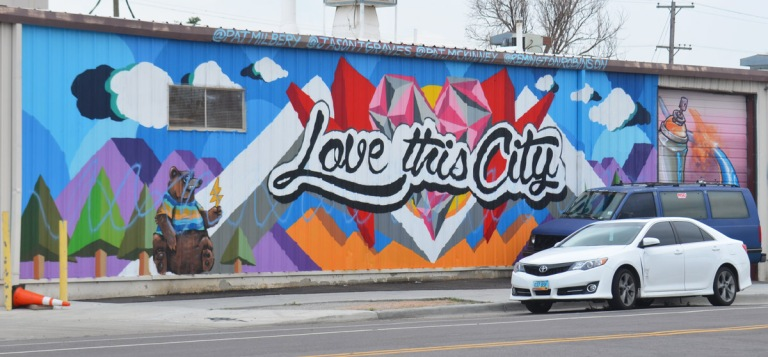 horizontal mural in Denver with cursive writing that says Love this city.