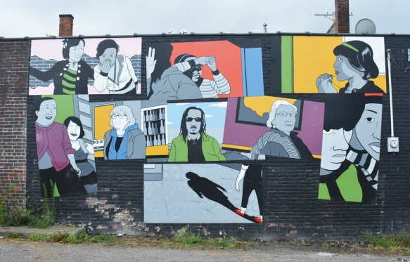 a mural that is a collage of faces of many people, simply painted, each within a square or rectangle, Cleveland street art
