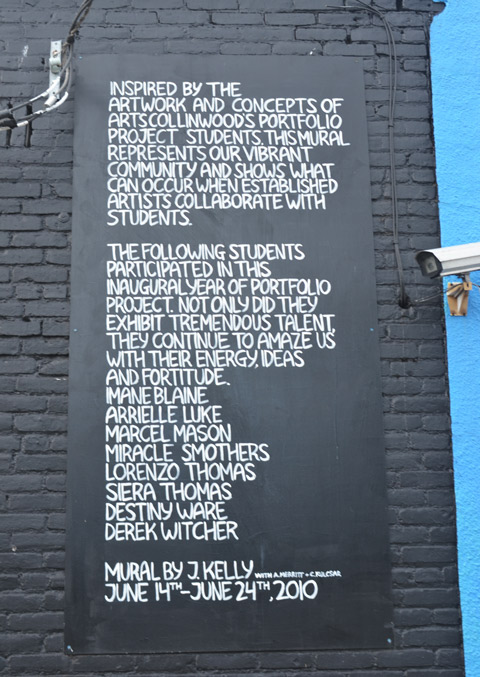 words painted on a wall beside a mural in Cleveland that thanks the people who made the mural