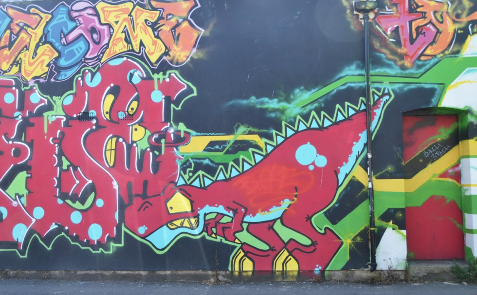 street art mural, animals, red dinosaur, with some text graffiti too