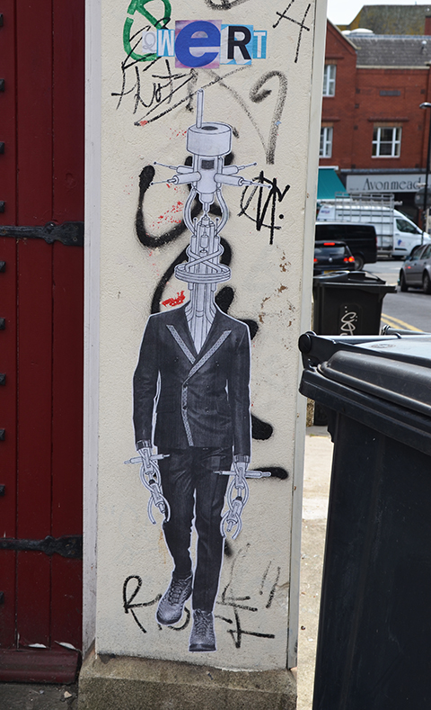 vertical paste up, man in suit and good shoe, but with head and hands as machinery