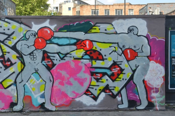 mural of naked men with red boxing gloves