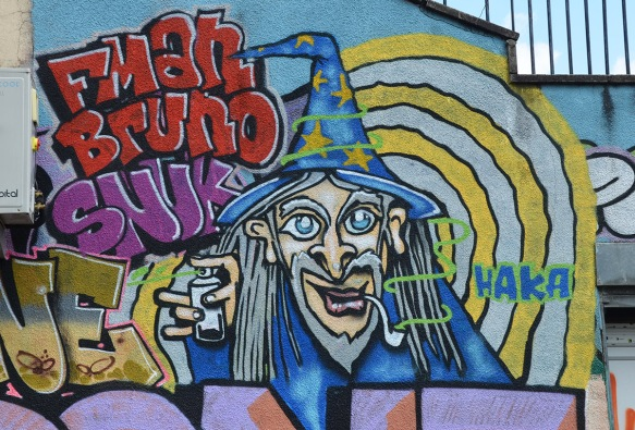 mural of a witch with wizard hat on blue with yellow stars