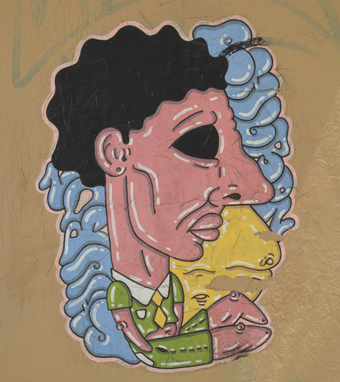 stylized painting of a man upper body with large crab hands, lack hair and blue writing (illegible) on both sides of his head.