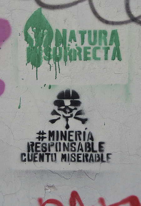 green stencil on top and black on the bottom that says mineria responsable cuentu miserable
