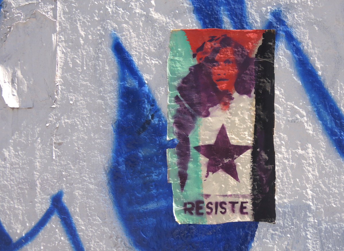 small paste up of a face and star with green and red parts