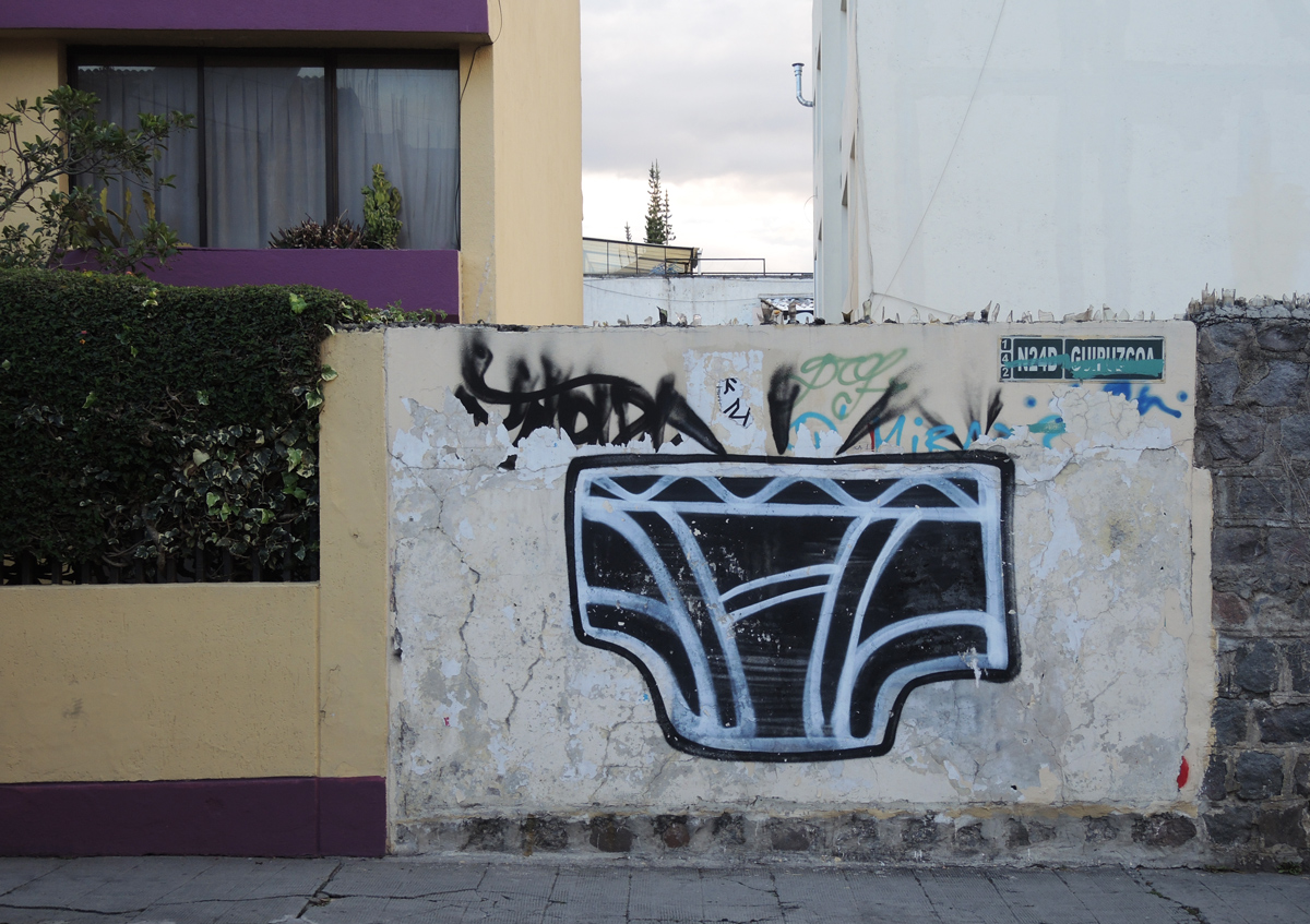 large black and white painting of a pair of men's briefs, underpants in Quito