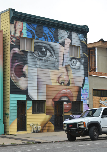 large woman's face covering the front of a two storey house, rectangle front, flat, cubist like style