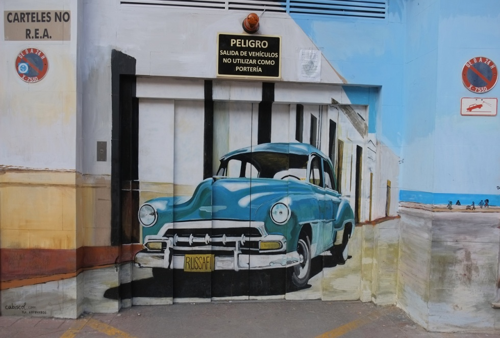 1950s blue car, American, licence plate syas russafa, street art of an old car painted on a garage door
