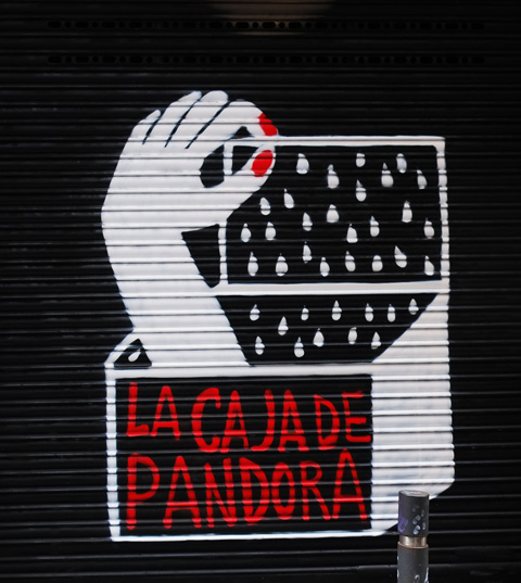 La Caja de Pandora, Pandora's box, in white on black background, a hand is coming out of the box, with bright red nail polish, box is open,