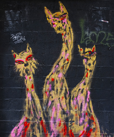 three long necked cats painting on a door