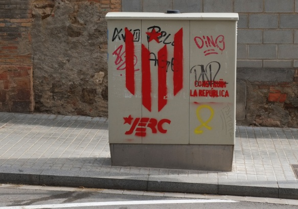 utility box with painted political statements graffiti