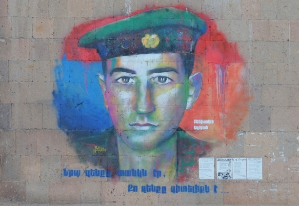 colourful mural of soldier's head, with uniform and hat