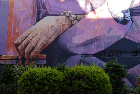 details of inti mural, hand with tattoos