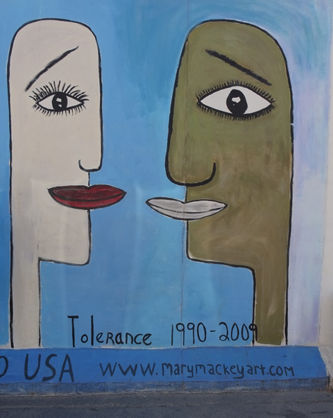 part of a mural on Berlin Wall, Eastside gallery, Tolerance by Mary Mackey of Denver Colorado