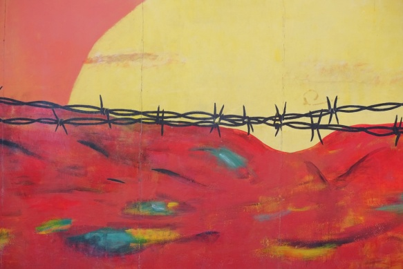 part of a mural on Berlin Wall, Eastside gallery - barbed wire