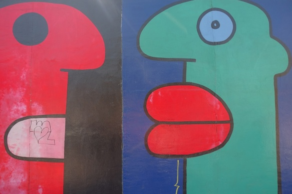 part of a mural on Berlin Wall, Eastside gallery, large faces by Thierry Noir