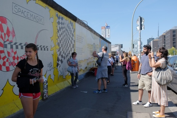 people in front of part of a mural on Berlin Wall, Eastside gallery