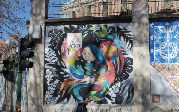 mural of a girl with two birds