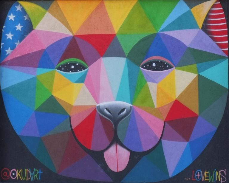 large animal face (bear?) in bright multi coloured triangles, by okuda (okudart)